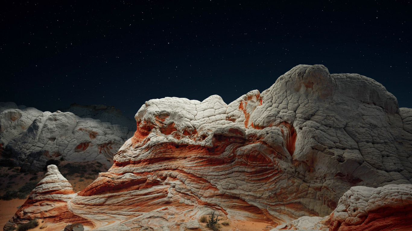 The night sky and desert valley wallpaper 1366x768
